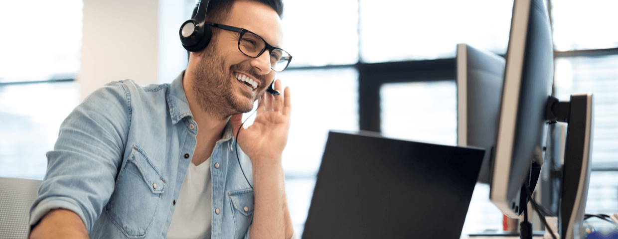happy businessman talking with headset, remote employee getting IT support or managed IT help