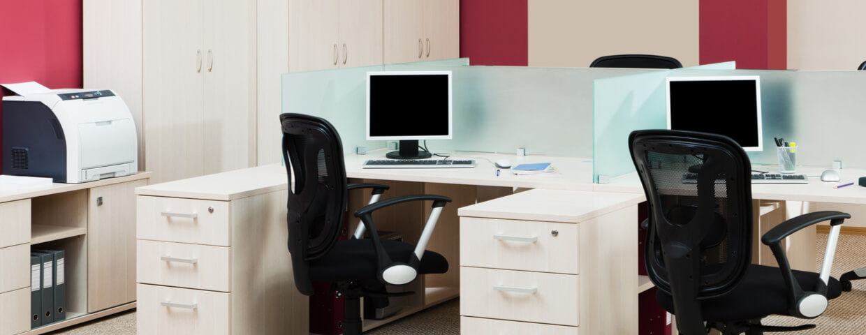 modern office with robust desktop printer right next to a small group of desks, multifunction printer fleet
