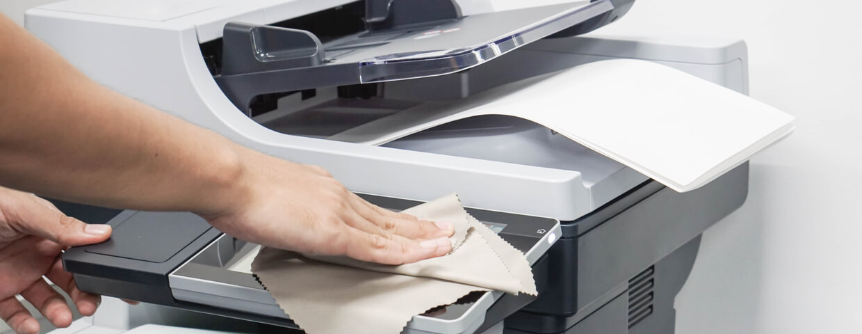 hand wiping or cleaning the touchscreen of a printer
